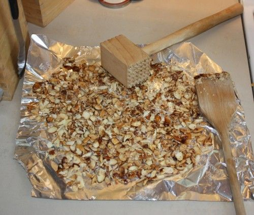 The side of a meat pounding mallet is very handy too, not just the pointy ends. Shown here crushing caramelized almond slices.