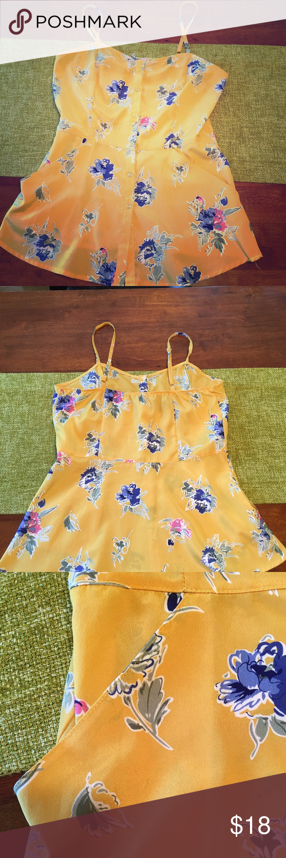 Super cute yellow floral tank! With pockets! Super cute tank for a casual day or evening! Buttons all the way up the front and has pockets! Tops Tank Tops