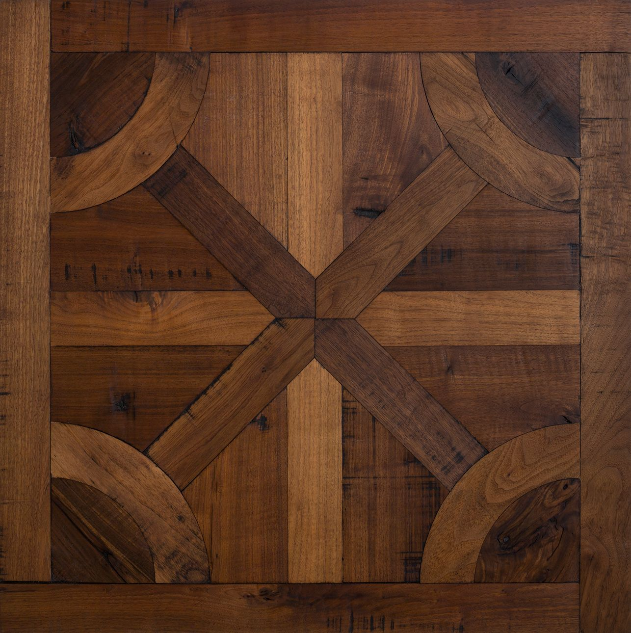A timeless parquet design of rustic walnut, assembled b …