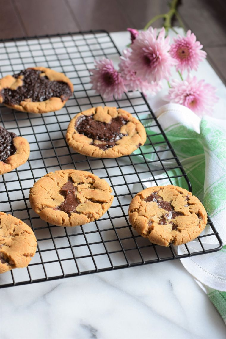 The most magical frosting filled peanut butter cookies - like a brownie/ cookie/ Reese's combo!