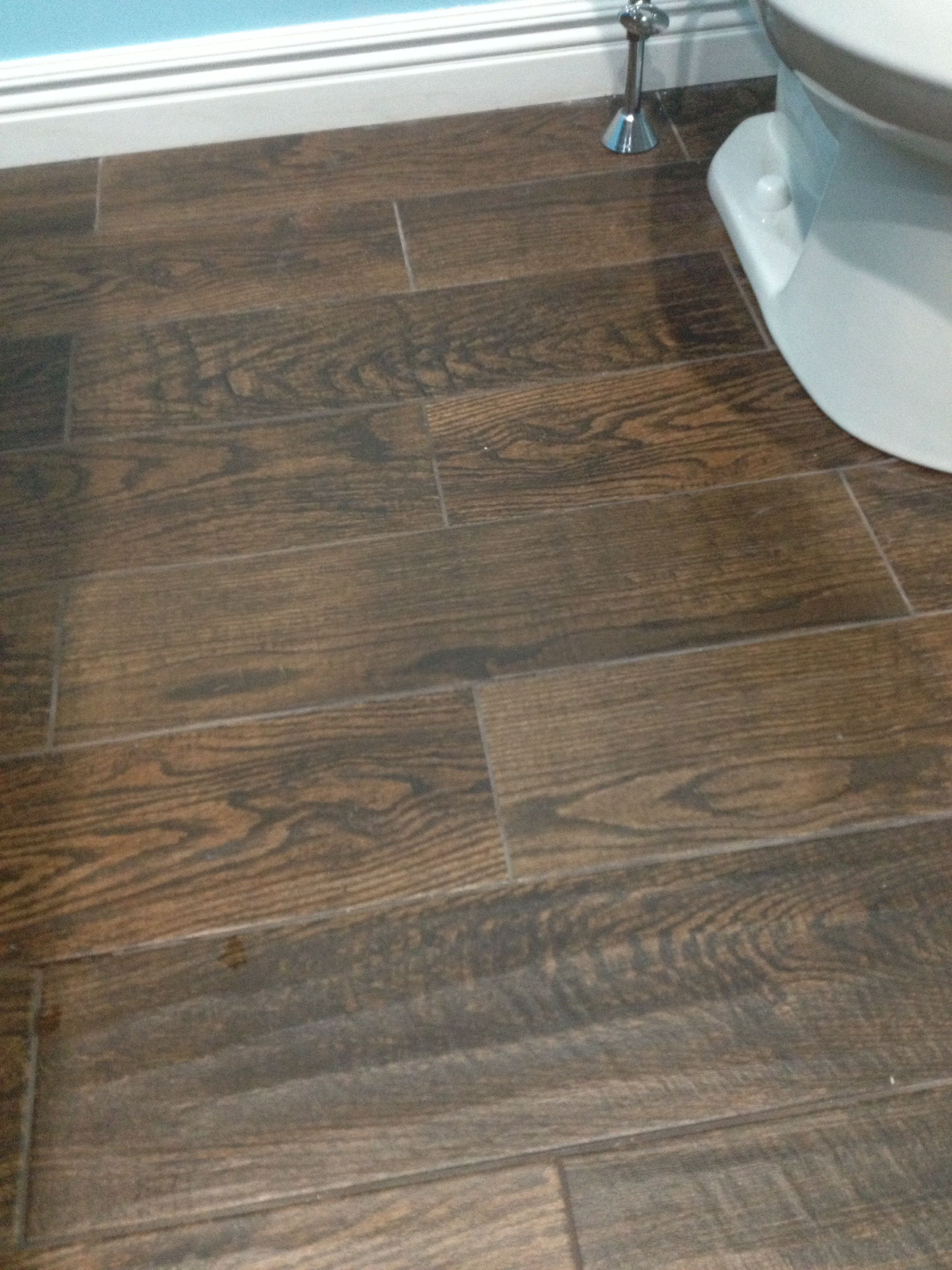 Porcelain wood look tile in upstairs bathroom home depot for Hardwood floors upstairs