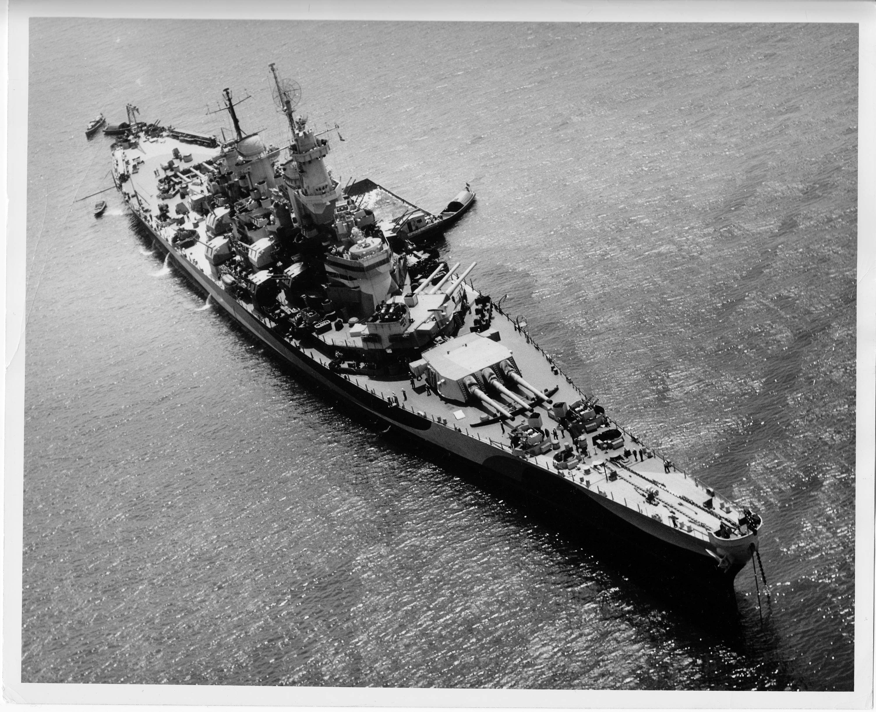 The Iowa was designed as a Fleet Flagship, like the South Dakota (BB-57). The Iowa was completed with a 20mm gun array on #2 turret so as not to block the view of the flag bridge, located below the conning bridge station.