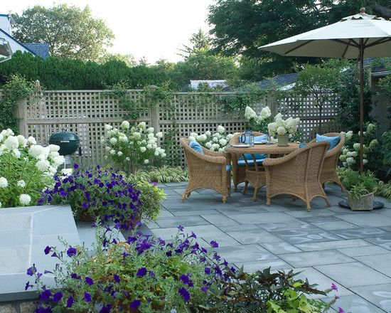 Love this landscape design of climbing roses, hydrangeas, and lilies ...