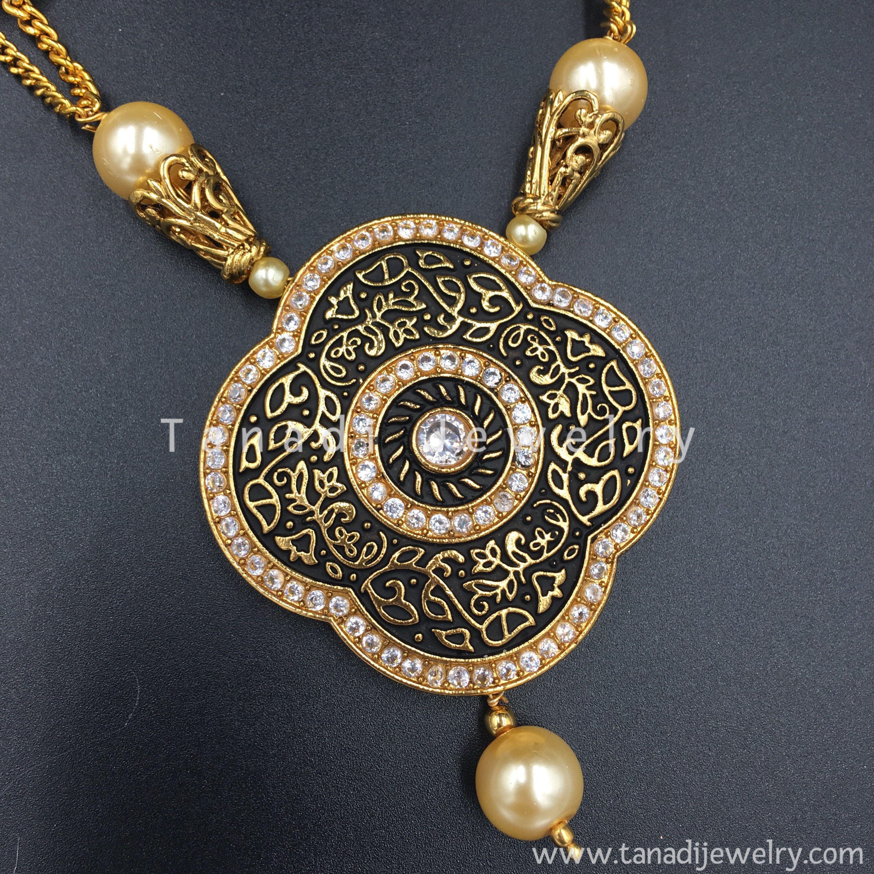 Black design flower pendant with white stones and cream moti