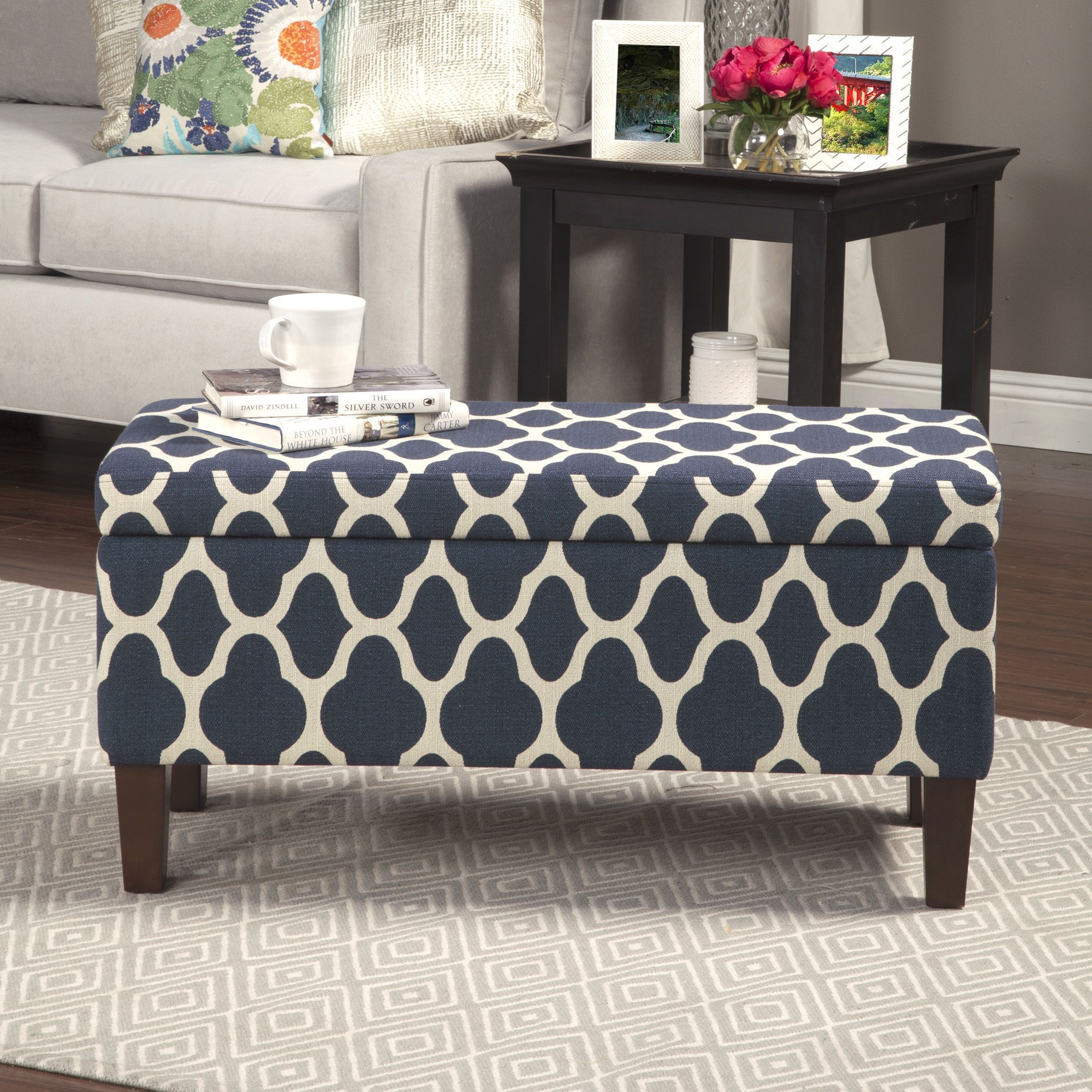 This impressive storage ottoman sports a decorative pattern and &le storage under a hinged lid. Use it anywhere in your home that you need a storage and ... & This impressive storage ottoman sports a decorative pattern and ...