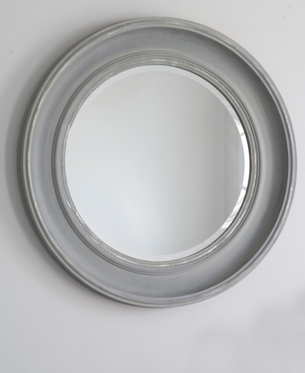 An easy round mirror ideal for a living room hallway or bathroom