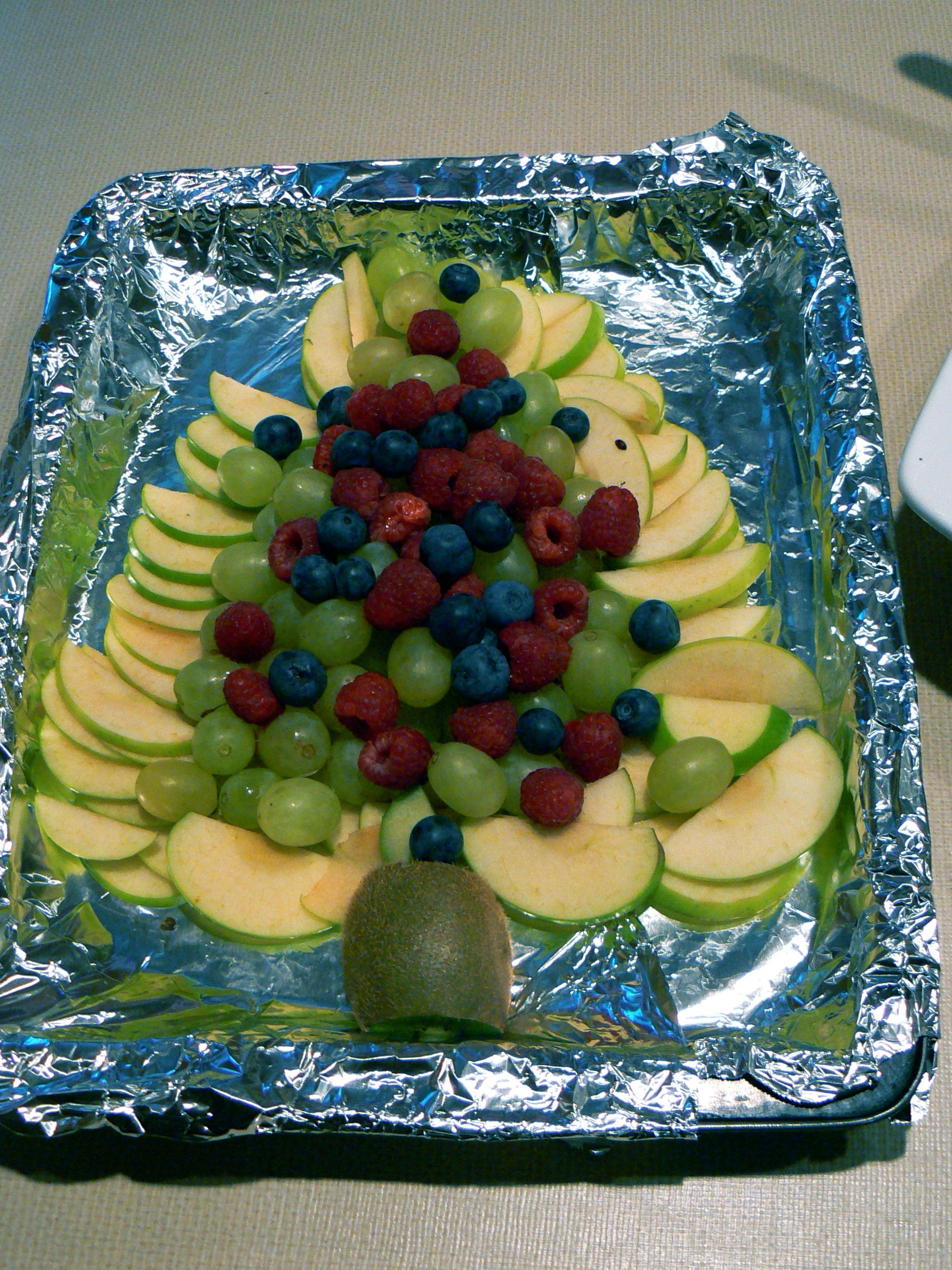Create a healthy, easy and festive treat for the kids:  A Christmas Tree fruit platter!