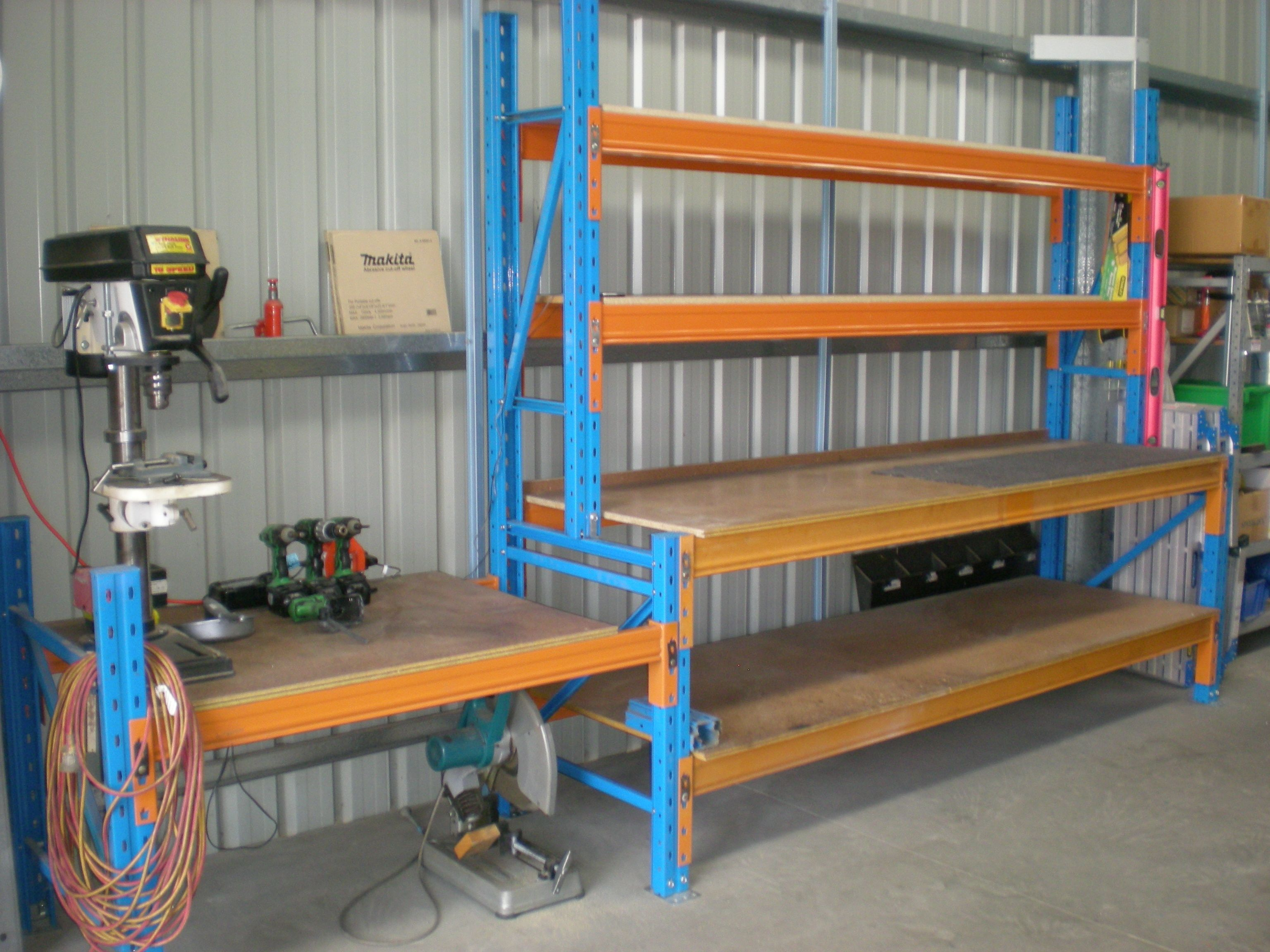 This workbench is extremely heavy duty as it is made from Pallet Racking.  A great way to store those big items and still have work space to use. Workbenches can be in found in sheds and warehouses.  http://www.racknstackwarehouse.com.au/products/cairns/workbenches/