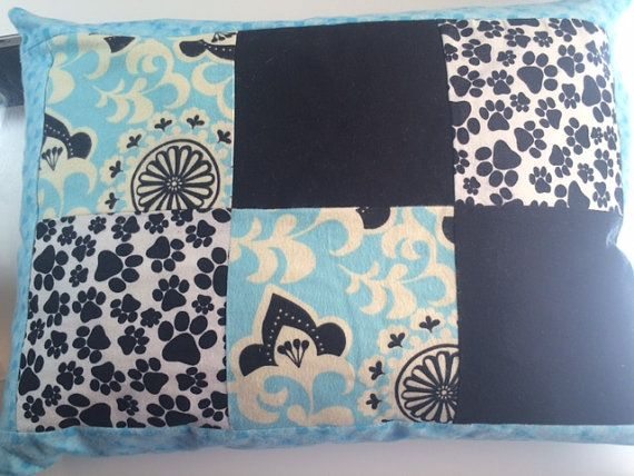 This blue, white and black dog pillow is pieced and handmade. It is made of 100% cotton flannel on the front and back sides with a 100% cotton