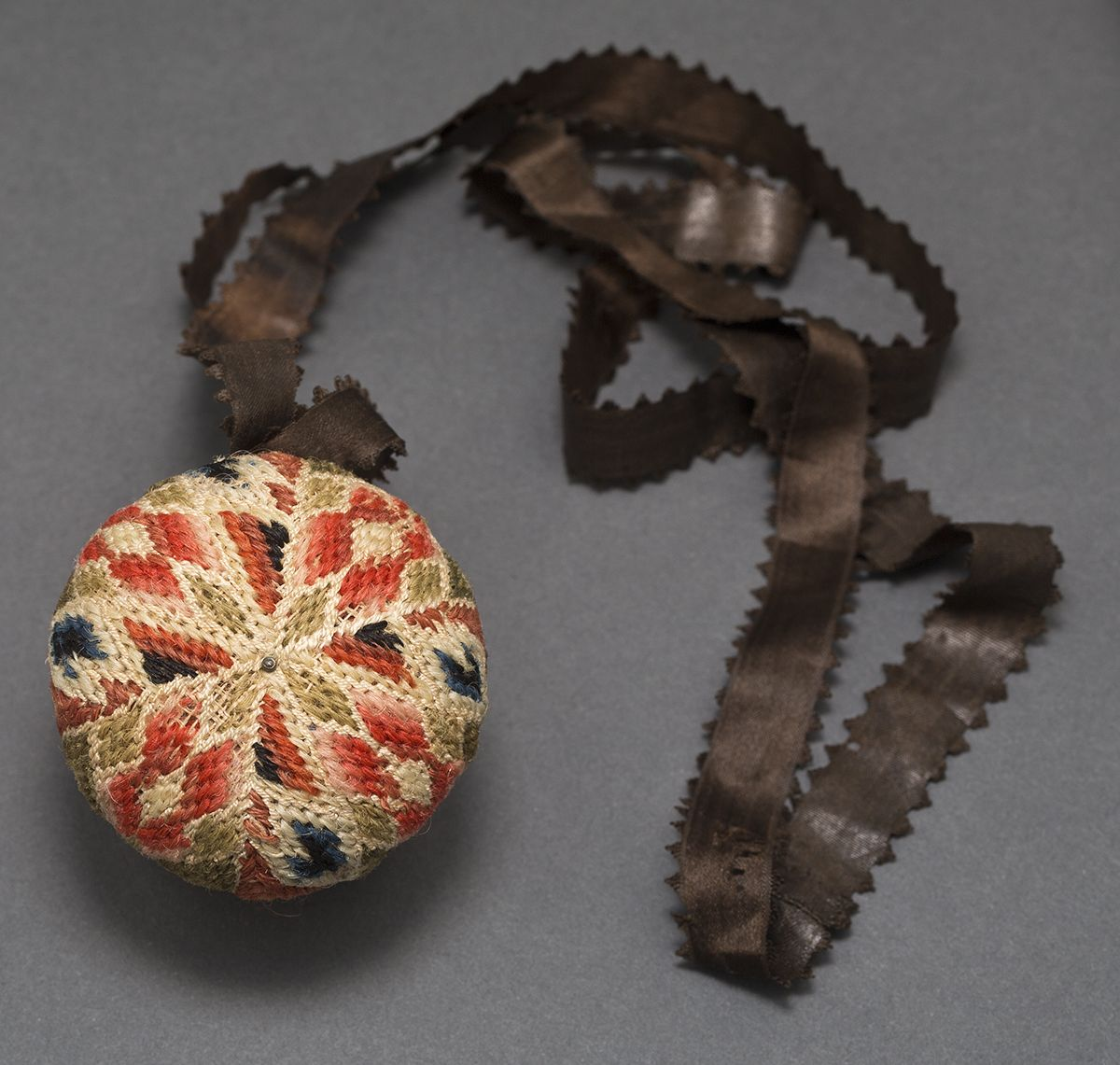 Pinball, Winterthur, Chester Pennsylvania. Linen, silk, wool, 2 inches (l) x 1.87 inches diameter, accession number 1976.0178