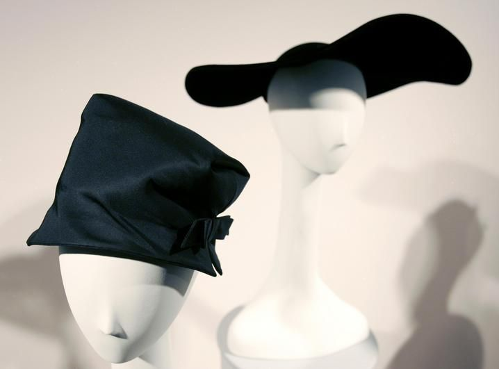 Hats with their matching dresses are displayed at an exhibit titled Lilly Dache: Glamour at the Drop of a Hat at the Museum at FIT in New York. Ms. Dache opened her first hat shop in 1924.