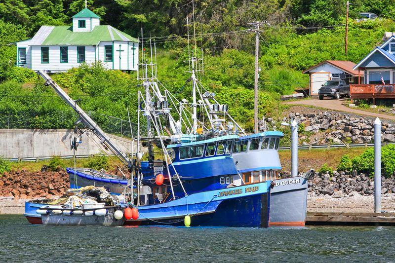Alaska Hoonah Fishing Boats. Fishing boats tied up along the waterfront of the t ,