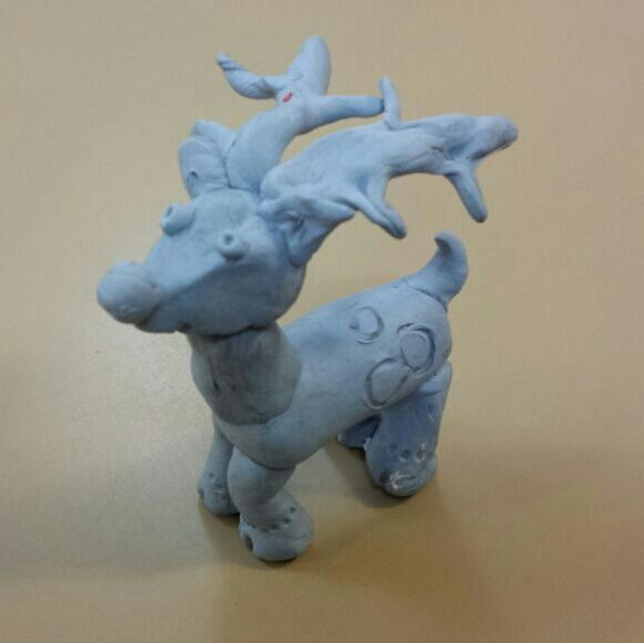 I was helping my Dad stick some posters up in his classroom, and I got bored. It was around Christmas time, so I molded a reindeer out of Blue-tac. My Dad even gave him a name, Bluedolf.
