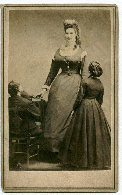 "Anna Haining Swan (August 6, 1846 – August 5, 1888). Famed for her great height, she was believed to be 2.27 m (7' 5½"") at the peak of her stature."