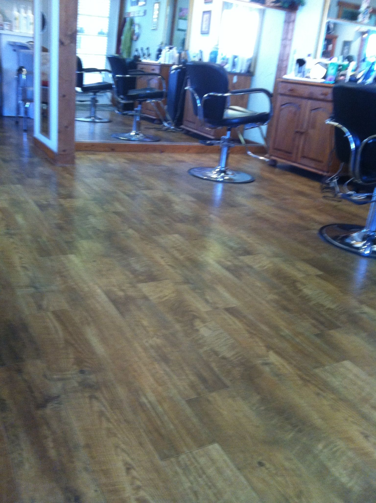 Amazing linoleum at my hair salon Looks and feels like wood