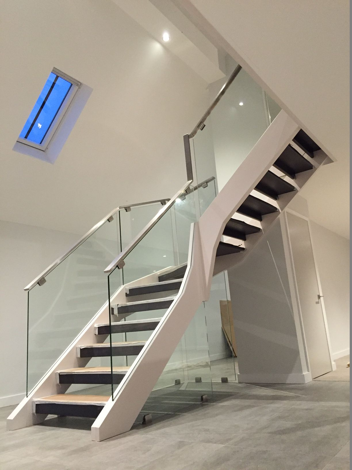 The Dark Stained Oak Treads And Glass Panels Make This Contemporary  Staircase Feel At Home Within This Recently Renovated Barn Conversion.
