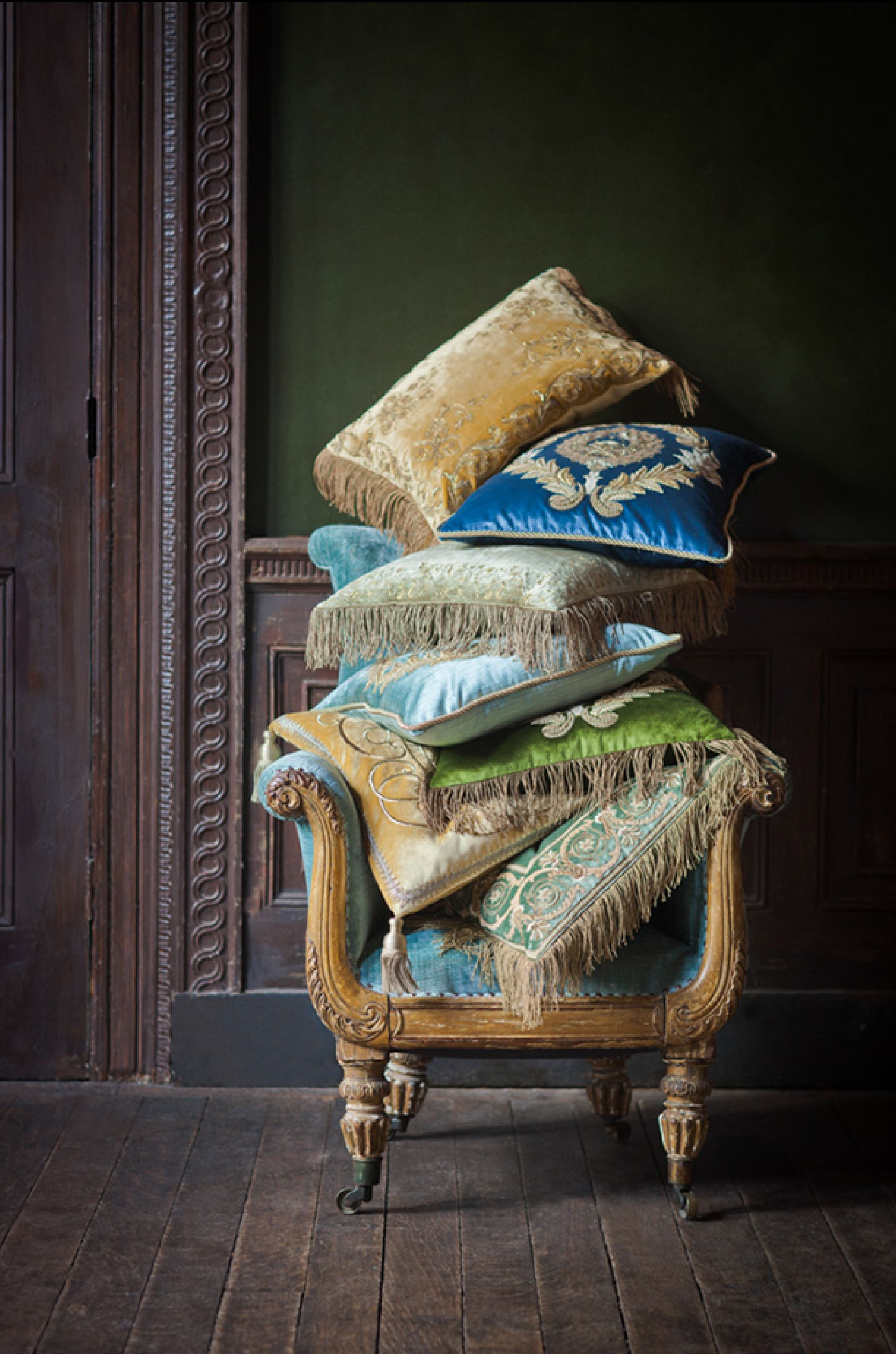 A pile of beautiful hand embroidered cushions from our Couture collection.