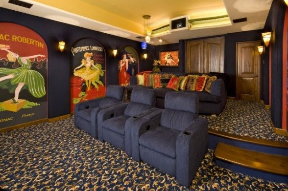 Oversized wall art, printed carpet, and rich blue seating really ...