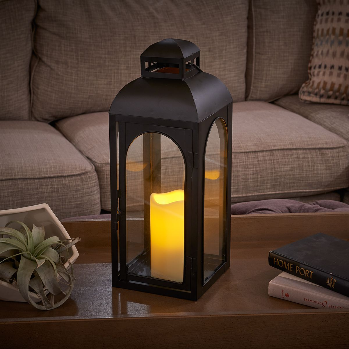 Moreno Candle Lantern: Flameless candle illuminates warm light on a timed setting - 6h on / 18h off. Perfect for those longer, dark days of winter or for summer evenings outdoors. #CandleLantern #Lantern #BatteryPowered #DecorativeLighting