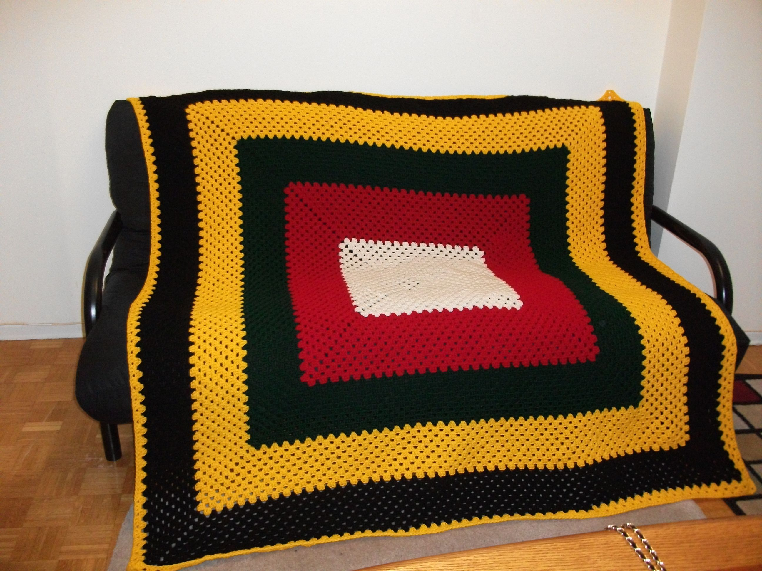 This is a blanket I made for a friend's birthday, he wanted it in colors of red, green yellow, black and off-white.