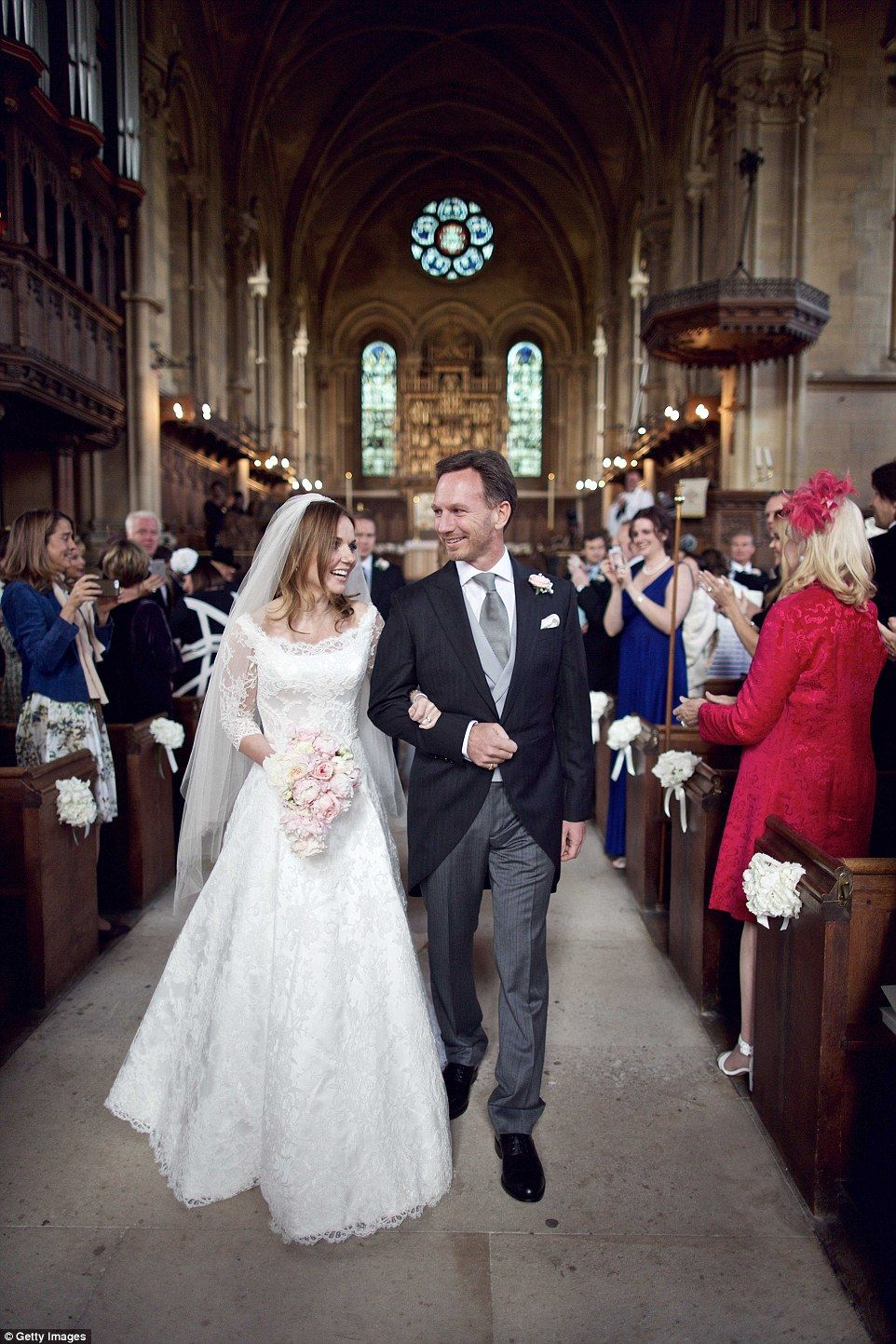 Geri halliwell kisses husband christian horner after church wedding