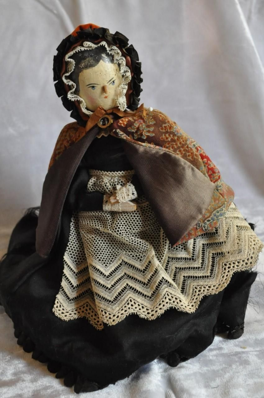 Old peg wooden doll