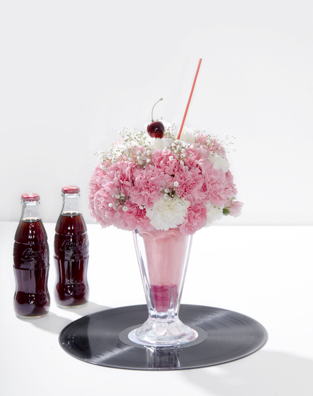 Grease centerpiece www.prunier.mx https://www.pinterest.com ...