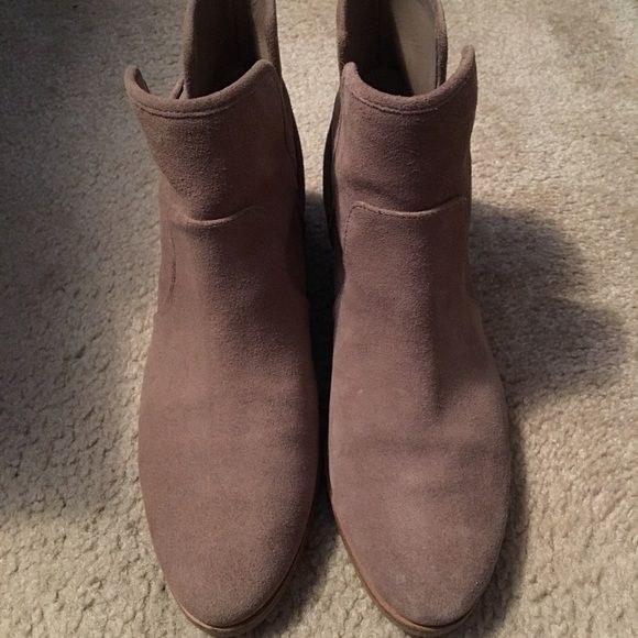 Michael Kors booties Tan/Natural Michael Kors booties-some wear on the soles but still in great shape. They match with anything! Michael Kors Shoes Ankle Boots & Booties