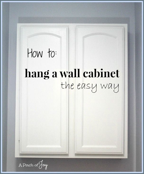 How To Hang A Picture On The Wall how to hang a wall cabinet the easy way -- a pinch of joy | great