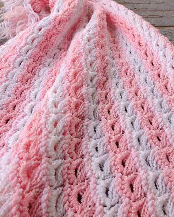 """Design By: Maggie Weldon Skill Level: Easy Size: 33"""" wide by 34"""" long Materials: Bernat Baby Coordinates - sport weight yarn - 12 ounces (1020 yards) each Pink"""