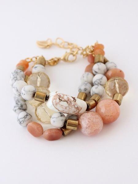 Triple strand bracelet with peach aventurine, hematite, howlite, lemon quartz, fire agate, and magnesite. David Aubrey LOLB04 $ 82.00