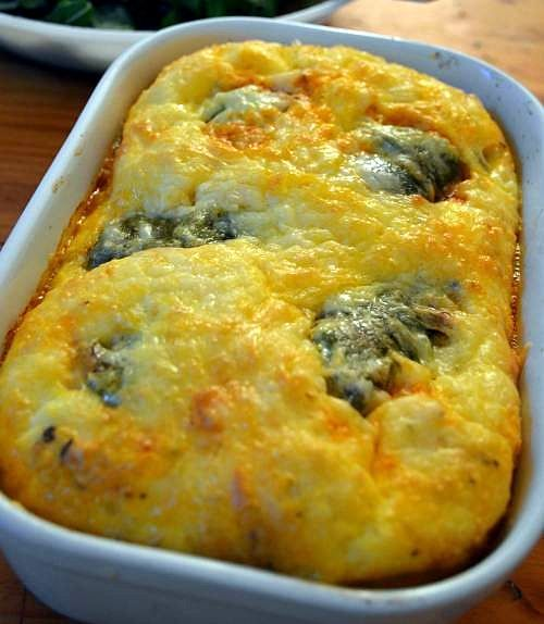 Chile Rellenos Casserole, poblano chiles, stuffed with cotija cheese and chorizo sausage, baked in an egg and cheese casserole with tomato sauce. On SimplyRecipes.com