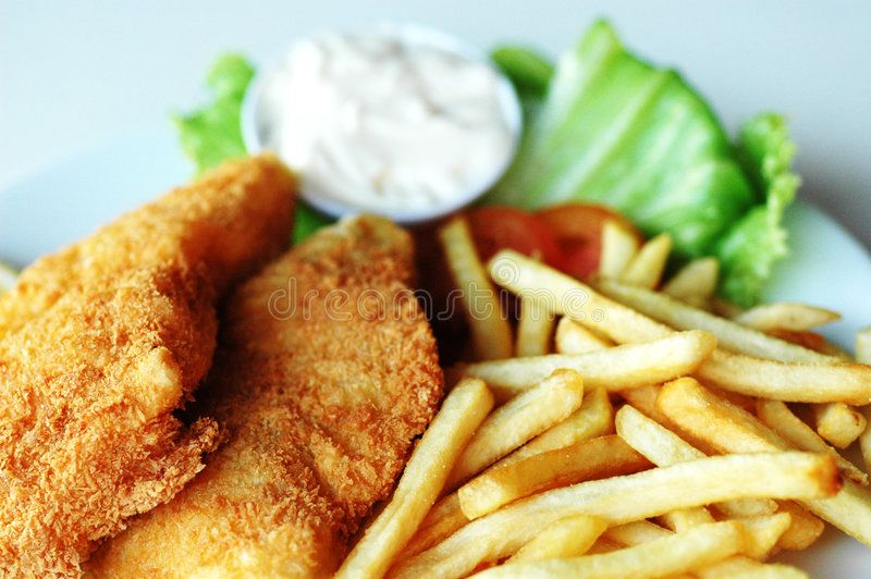 Fish and chips. Served with cream and vegetables ,