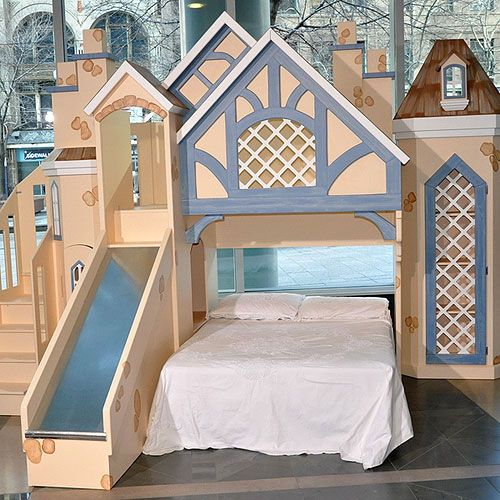 Chantilly Chateau Bunk Bed  Your little one deserves their very own chateau straight from the Loire Valley.  Features include: winding staircase for loft access, slide, octagonal tower with cathedral windows, bookcase tower with gridded door access, classic gable in gable roof line. Accommodations for a full size mattress on the ground floor and twin in the loft.