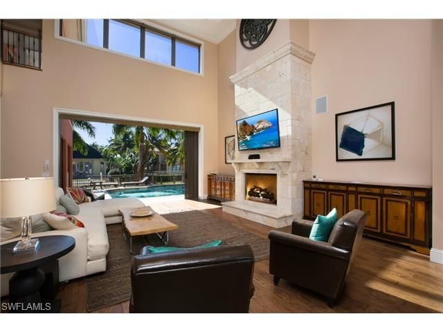 two story living room with stone fireplace  14th ave