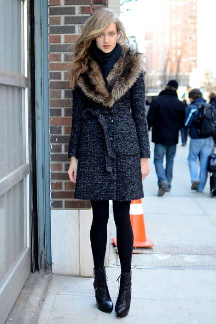 Uptown elegance that's perfect for the downtown girl? A fur collared coat. #streetstyle