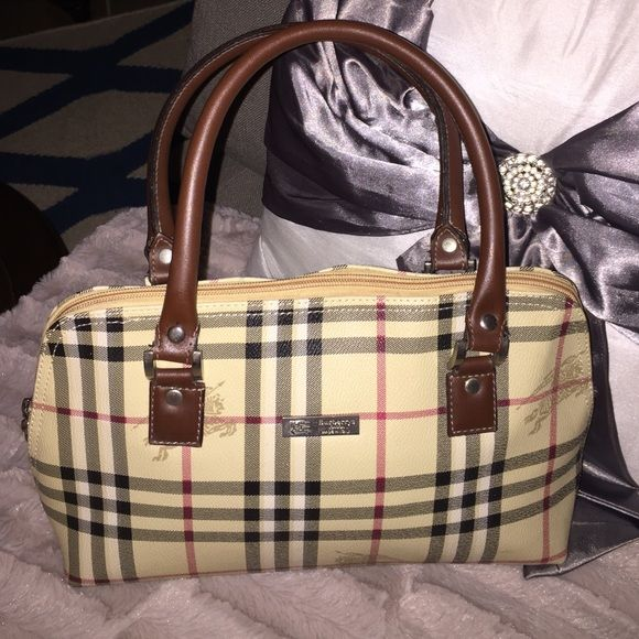 0b756aea845 Vintage Burberry London Handbag It is an original vintage Burberrys London  handbag. It has that beautiful classic print. Some minor marks on the  handle, ...