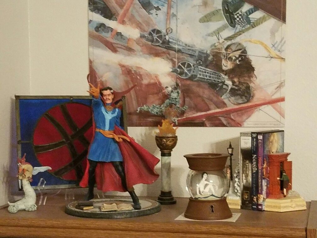Random Dr. Strange goodness from my house. The stained glass was made by a local artists. The painting is by George Pratt, a promo given with the purchase of the graphic novel of the same name, Enemy Ace: War Idyll.