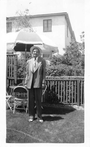 Photograph Snapshot Vintage Black and White: Man Smile Suit Hat Yard 1950's