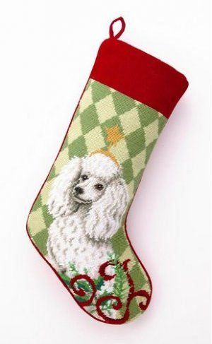 Holiday Poodle Needlepoint Stocking, from Dogstuff.com. Because your best pal wants treats from Santa, too. This festive stocking is done in impressive 100 percent wool needlepoint. Features a soft velveteen backing and a loop for hanging by the chimney with care. Christmas stocking measures 18 x 11 in...