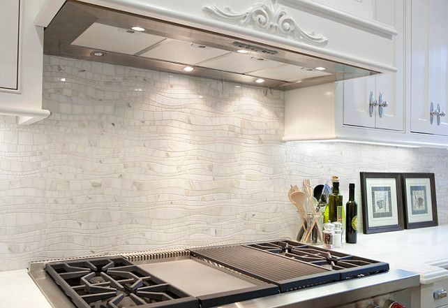 Dutch Colonial Home The backsplash is a calacatta marble mosaic called  sinuous wave by Artistic Tile