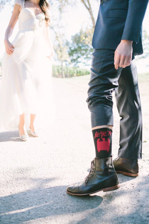 groom in Slayer socks to show off his personal style. http://www.weddingchicks.com/2014/01/31/vintage-barn-wedding-2/