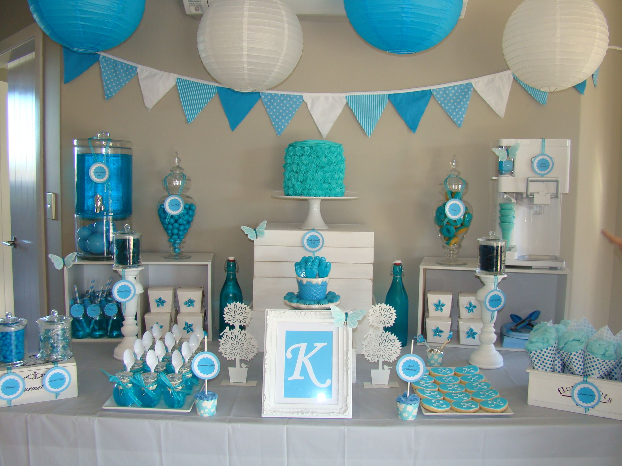 Blue themed candy dessert table baby shower Baby shower table setting