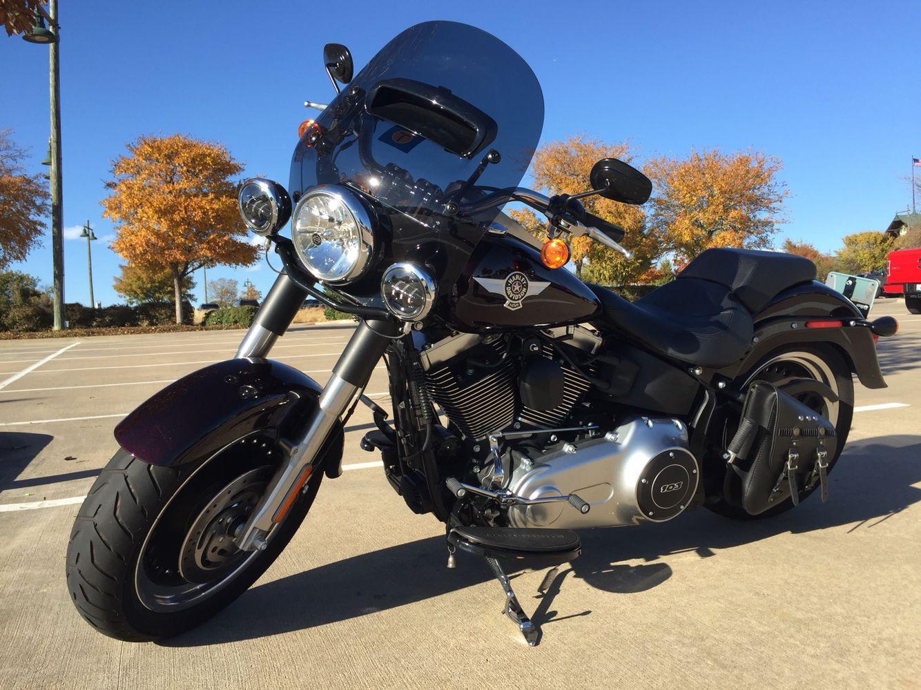 My new ride, a 2014 Fat Boy Lo in blackened cayenne sunglo. #HarleyDavidson #motorcycles