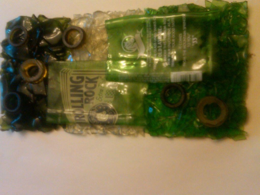 Artwork made using Rolling Rock beer bottles