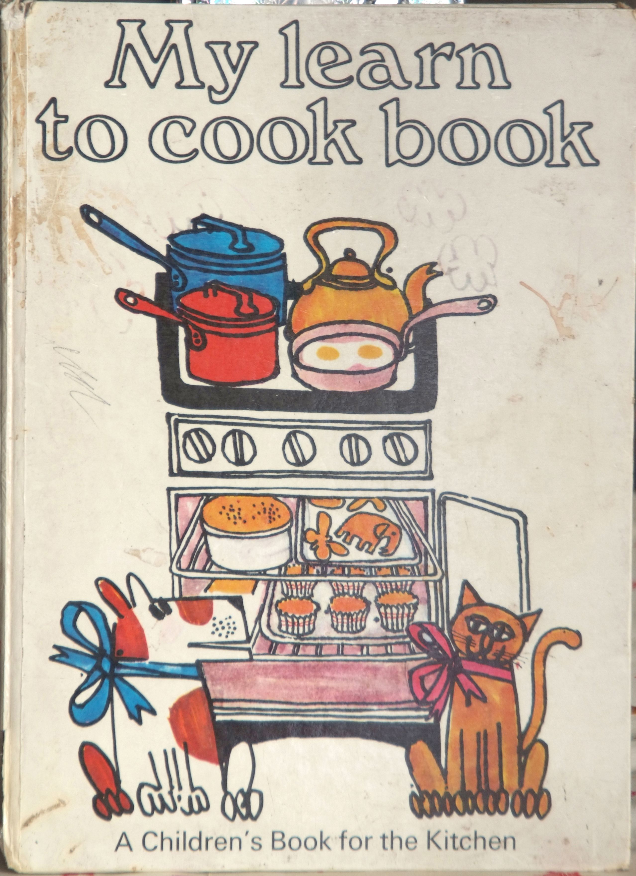 I had this book as a child! My learn to cook book by Ursula Sedgwick, illustrations by Martin Mayhew.