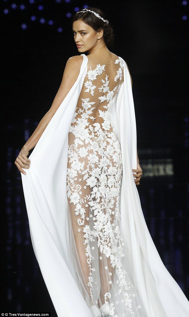 Showstopping  The brunette beauty rocked another dress with a fully sheer  embroidered back. 5b6833fea8a