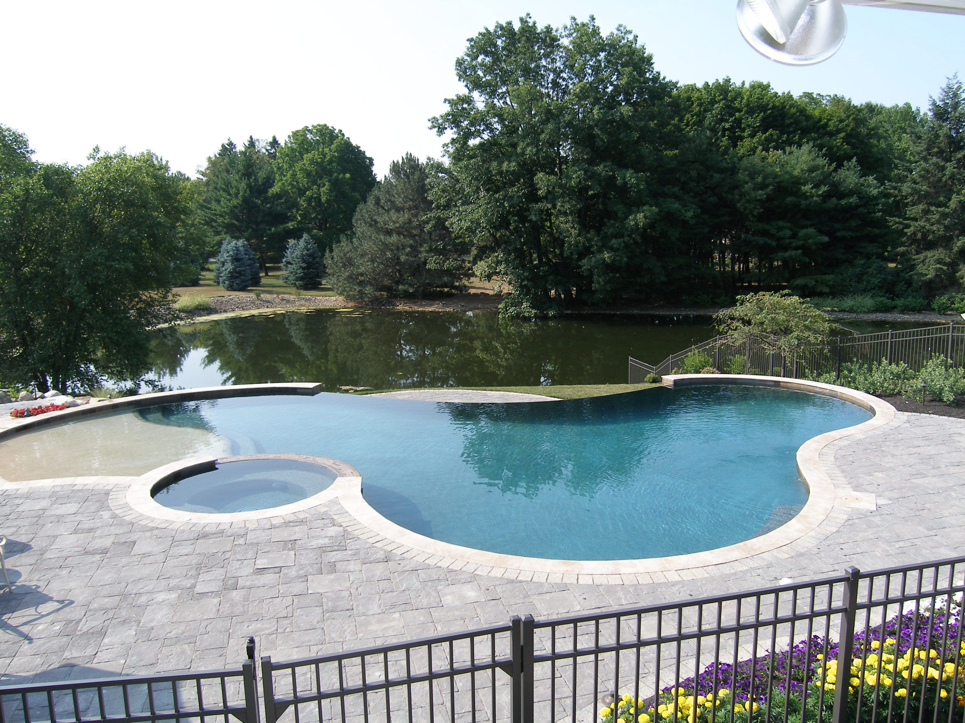 Freeform Gunite Pool With Spill Over Spa Beach Entry And 40 39 Negative Edge With Waterfall Plus