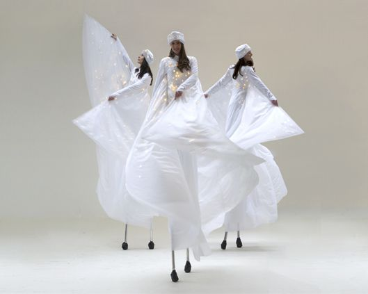 Optioscopes in white, stilt performance   Divine Company