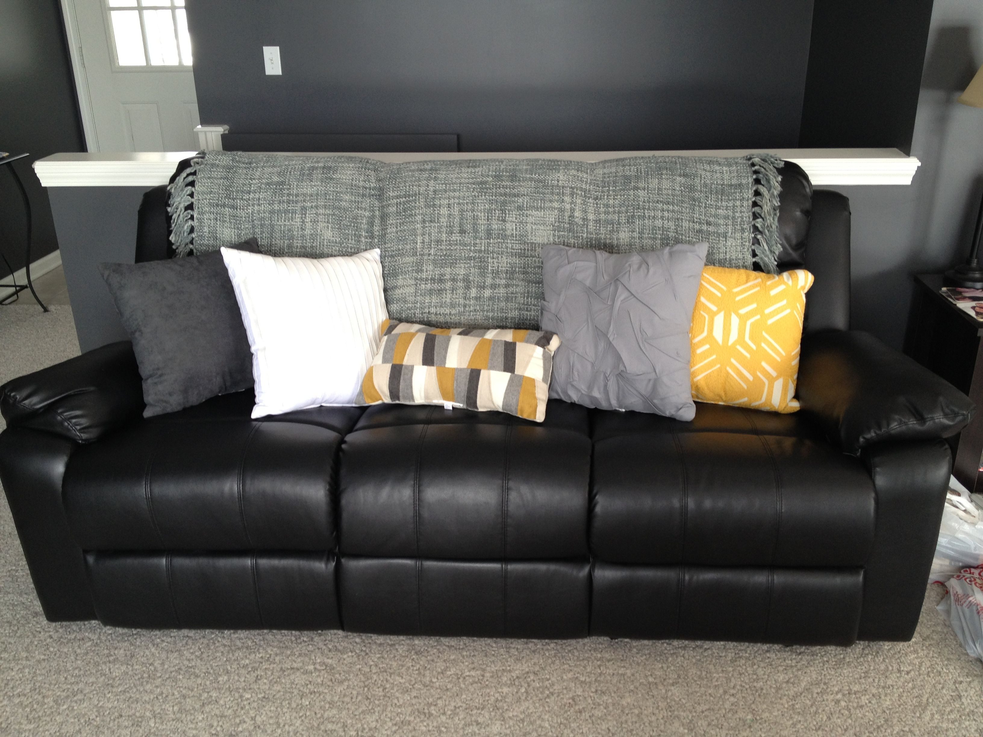 Lighten up a black leather couch with bright pillows and a ...